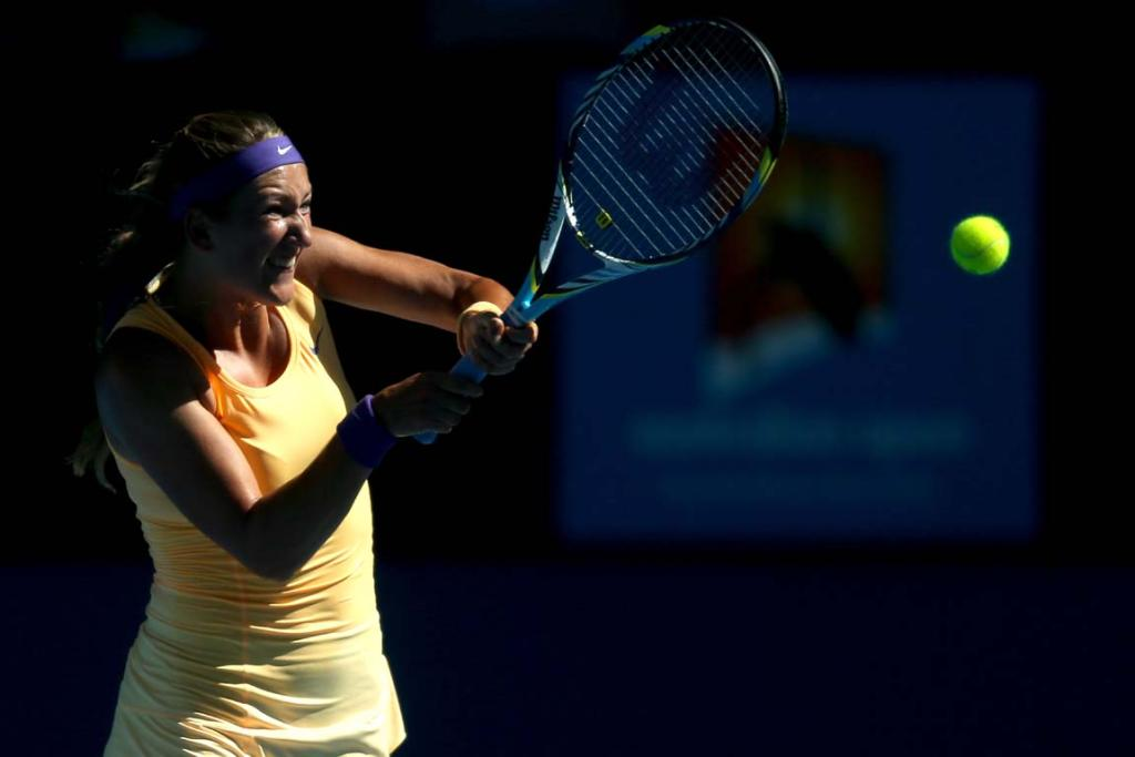 Victoria Azarenka of Belarus plays a backhand in her Semifinal match against Sloane Stephens of the United States.