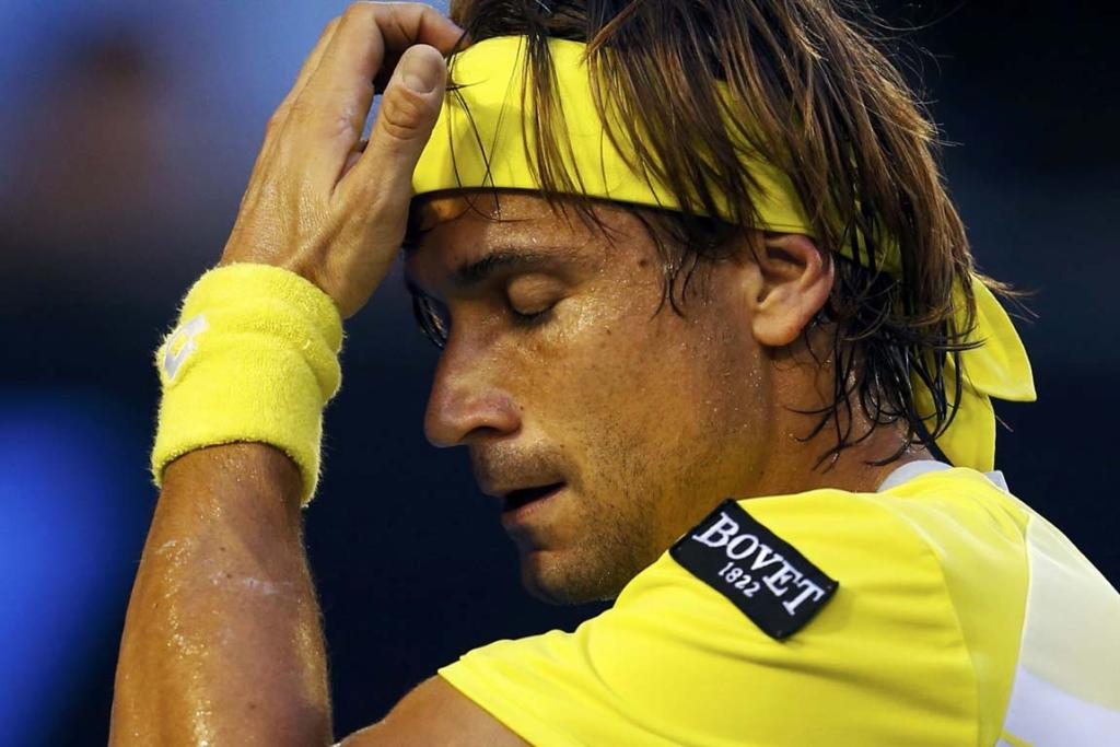 David Ferrer of Spain reacts during his men's singles semi-final match against Novak Djokovic of Serbia.