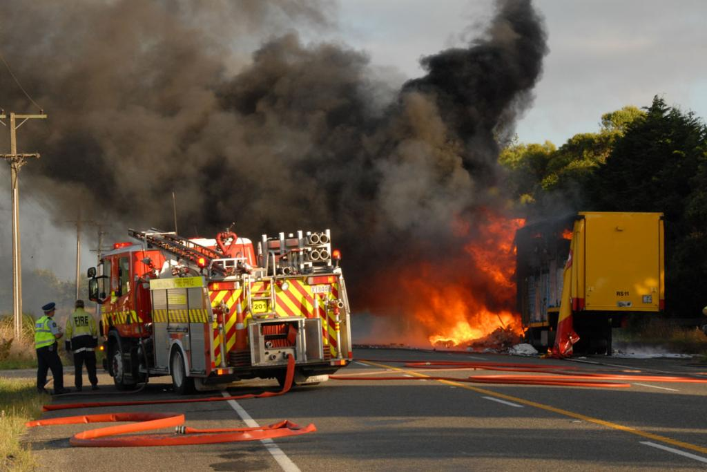 Firefighters try to control the truck fire on Rangitikei Line.