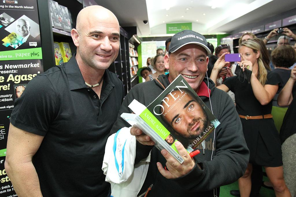 Andre Agassi poses with Ben Buist after signing his book.