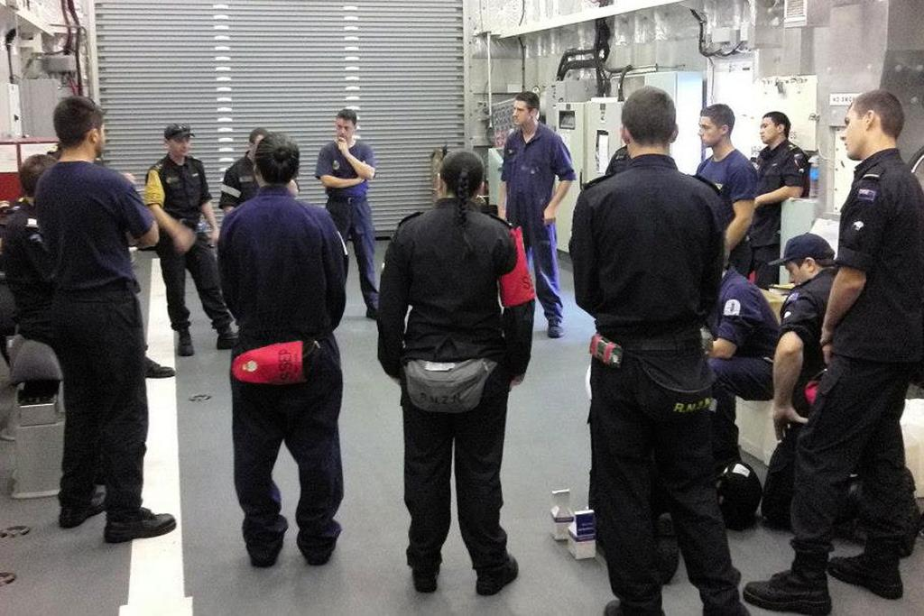 Navy staff aboard the HMNZS Otago are briefed as they head for Whangaparapara Harbour, Great Barrier Island.
