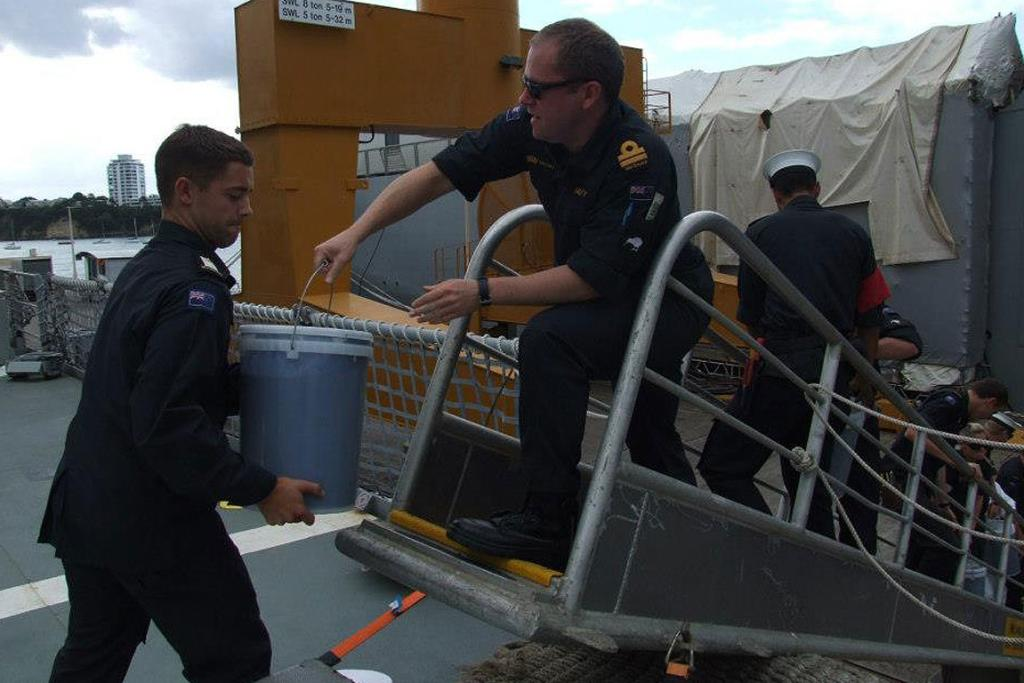 Navy staff load supplies onto the HMNZS Otago.