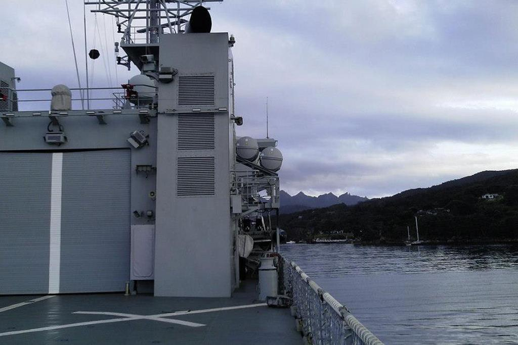 The HMNZS Otago is anchored at Whangaparapara Harbour, Great Barrier Island.