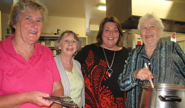 Volunteers Ngaire Gray, Meg Agnew, Jenny Hogg and Myra McNatty prepare lunch for all the visitors to the Age Concern centre in Forth St.