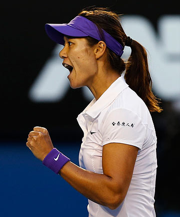 Li Na of China reacts during her women's singles final match against Victoria Azarenka of Belarus at the Australian Open.