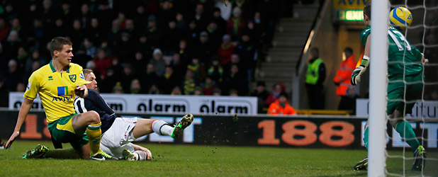 DIRECT HIT: Luton Town's Scott Rendell, second left, scores past Norwich City's goalkeeper Declan Rudd during their FA Cup fourth round soccer match at at Carrow Road.