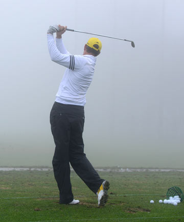 NO PLAY: England's Greg Owen hits balls into the thick fog from the practice range during a delay for the third round of the Farmers Insurance Open.
