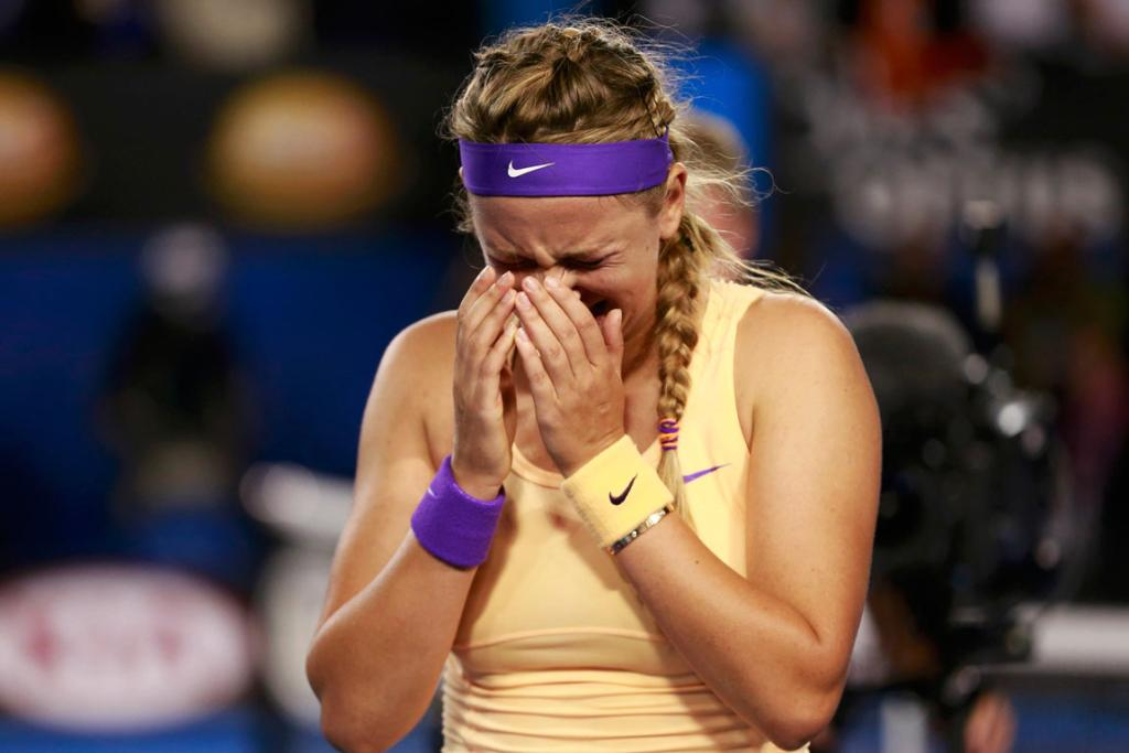 Victoria Azarenka bursts into tears after defeating Li Na for back-to-back Australian Open titles.