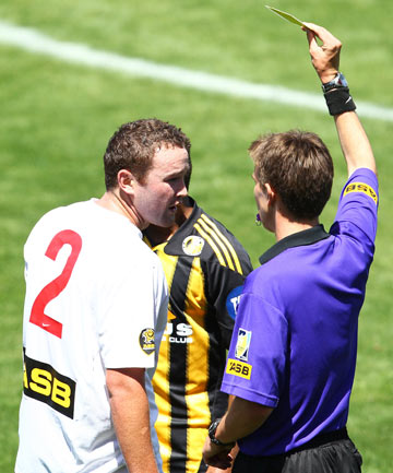 CAUTIONED: Waikato FC's Hone Fowler is shown a yellow card during their NZ Football Premiership match against Team Wellington.