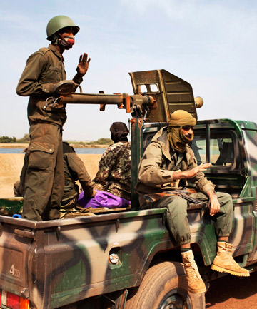 WELCOME SIGHT: Malian soldiers ride in an army pickup truck in Diabaly.
