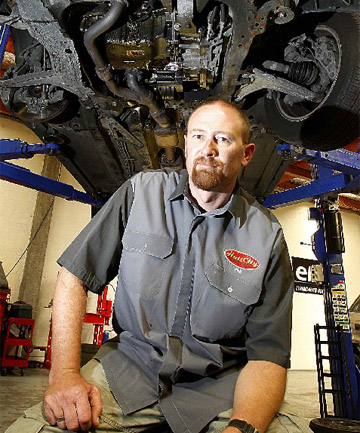 SAFETY CHECK: Hutt City Auto service manager Phil Row under a car in the workshop.