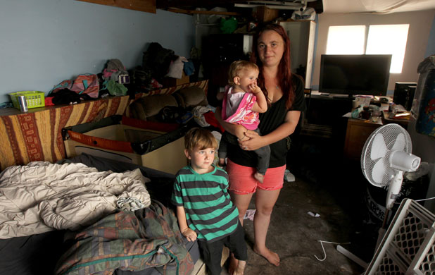 BARE BONES: The housing crisis in Christchurch has left mother-of-two Amber Breiter with no choice but to live in a single garage.