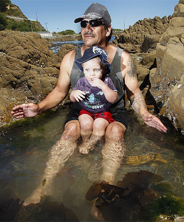 SWIMMING YES, SEAFOOD NO: David Lloyd and his son Sam enjoy the fine weather at Owhiro Bay despite the warnings about water quality.