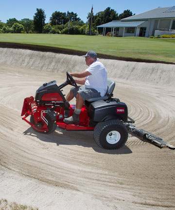 NEW GROOM SWEEPS CLEAN: Hokowhitu assistant greenkeeper Ian Wilce aboard the Manawatu Golf Club's new Sand Pro bunker rake on the 18th as the course is prepared for the LawnMaster Classic.