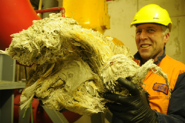 Scooped goop: Hutt Valley Water Services maintenance fitter Murray Gilmer holds a wad of unflushable items fished out of a pump at the Ava Pump Station.