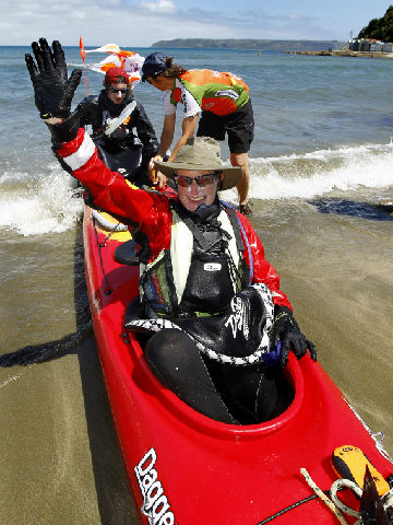 LANDED: Sarah Wilson gives a wave as she lands at Titahi Bay beach to complete the Cook-to-Cook challenge on January 21.