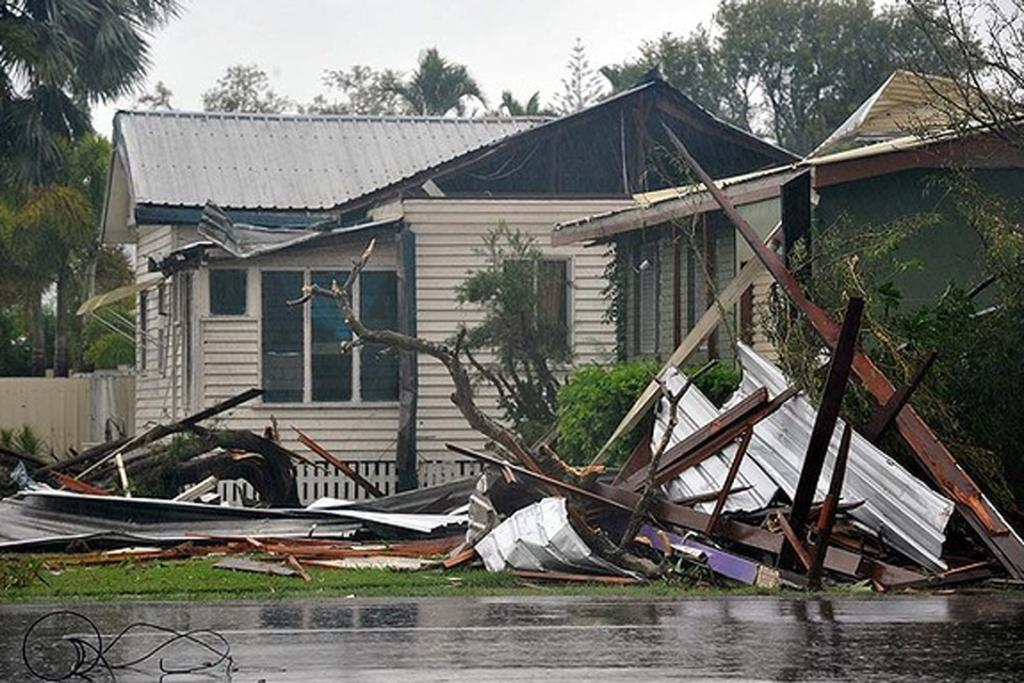 Bargara, east of Bundaberg, was slammed by a vicious storm, uprooting trees, downing powerlines and ripping roofs off houses.