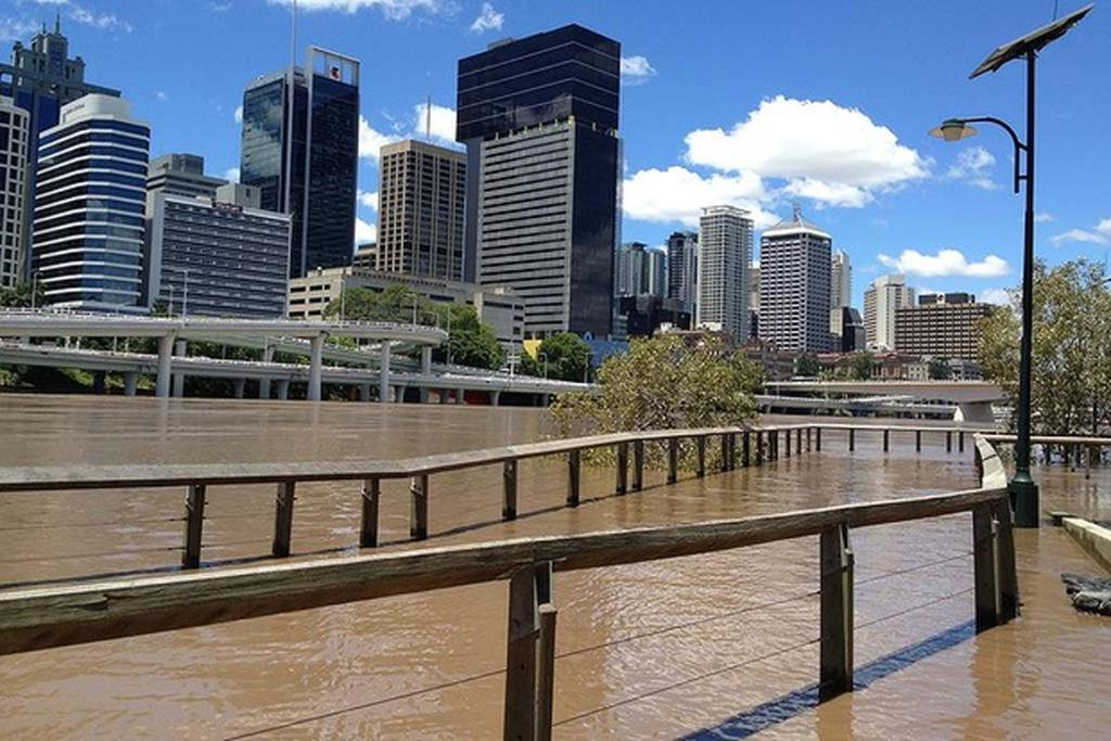 Water covers the bike path on the South Bank, Brisbane.