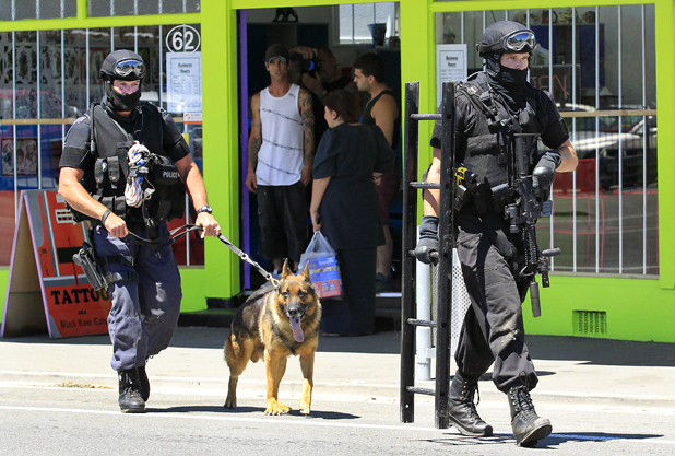 SIEGE: Armed police outside the Black Rose tattoo parlour in Main St, Blenheim, today.