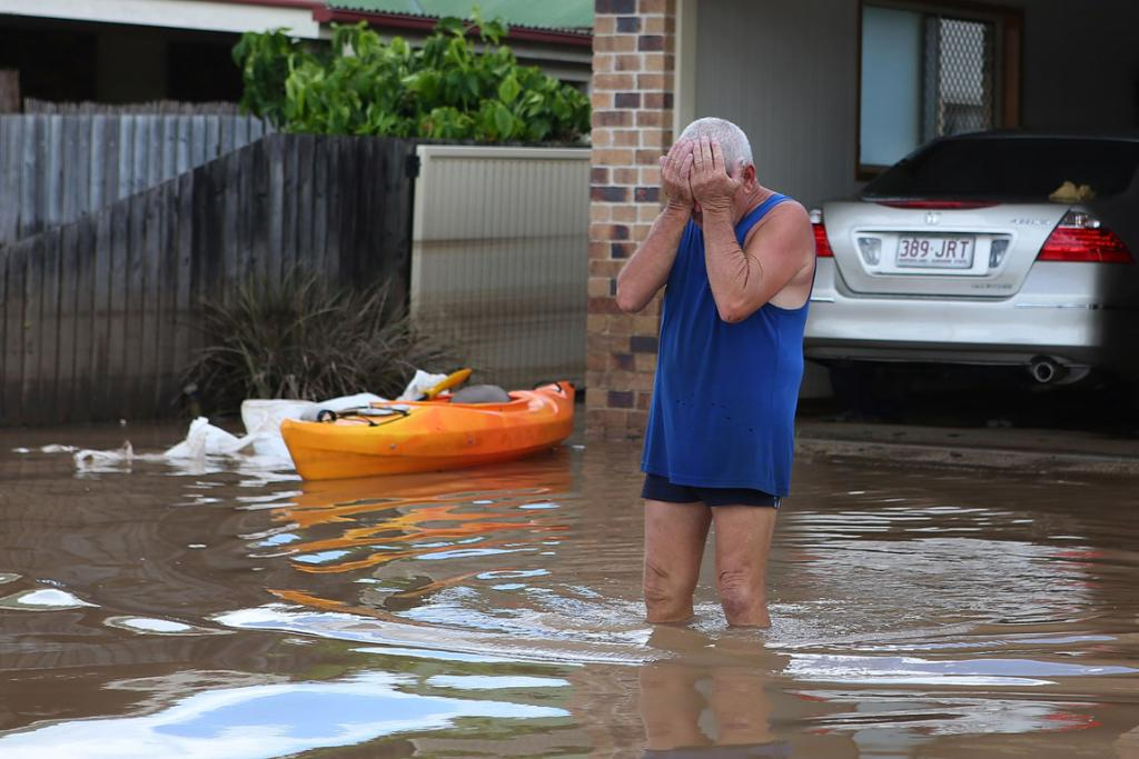 The site of the damage in Bundaberg proves too much for this local.
