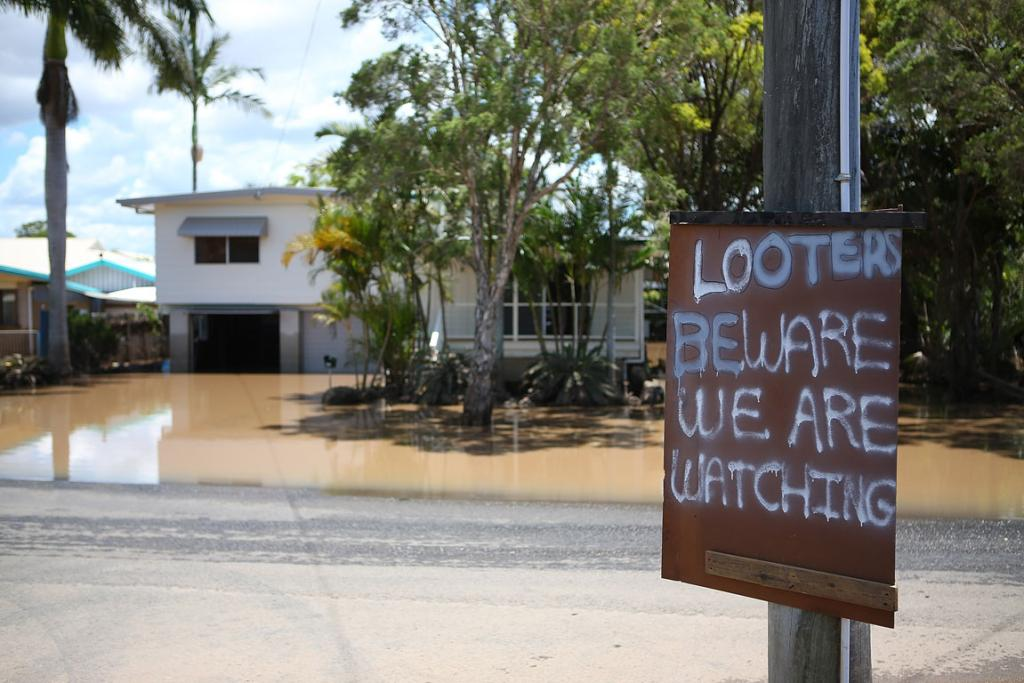 This sign was put up in East Bundaberg after reports of looters.