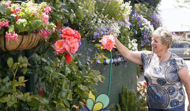 GREEN FINGERS: Ngaire Orford tends to her award-winning garden.