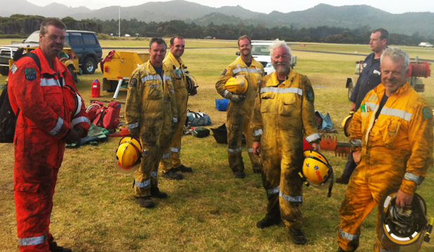 FRONTLINE FIREFIGHTERS: Rodney volunteer firefighters help at Great Barrier Island's scrub fire on Auckland Anniversary weekend. From left: Martin Duytshoff from Kawau Island, Scott Noyes of Puhoi, Luke Bianca and Oliver Trottier of Matakana and Ian Creusen-Foot, Steve Lockett and Rob Beardmore from Puhoi.
