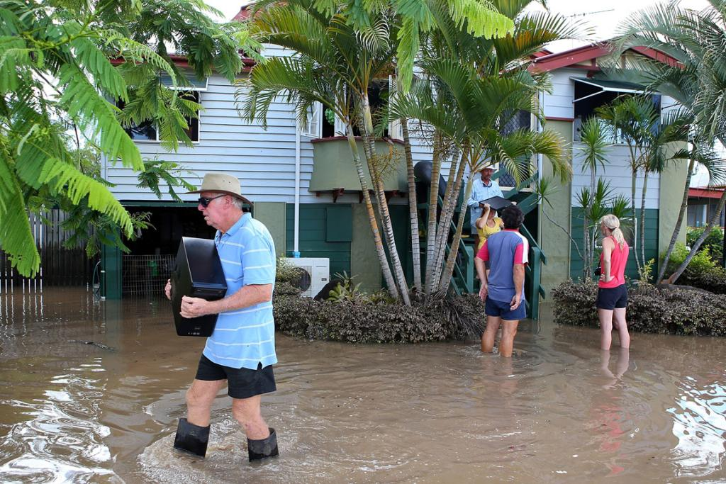 Residents collect belongings from their homes as the flood waters recede in Bundaberg.