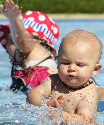 Noah Kitto, 9 months, splashes in a paddling pool on the Picton foreshore.