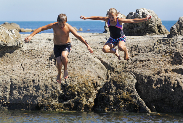 Swimming at South Bay, Kaikoura.Siblings Charlotte, 10 and Riley Smith, 8, have a water fight.