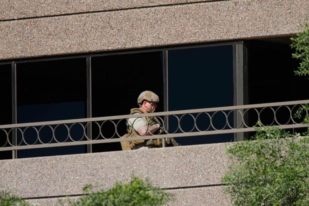 A member of the SWAT team moves into the building.
