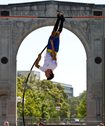 UP AND OVER: Nick Southgate demonstrates his pole vaulting skills by the Bridge of Remembrance.