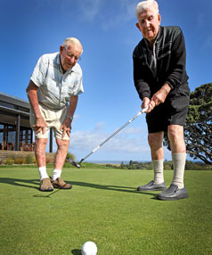New Plymouth Golf Club member Eric Rowlands, left, monitors a good-looking putt by clubmate Jack O'Carroll.