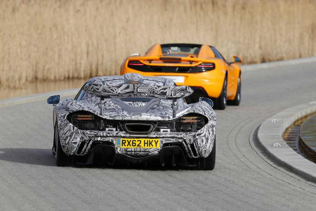 "Jenson Button drives the camouflaged XP prototype version of the McLaren P1 while his teammate Sergio ""Checo"" Perez controls the McLaren-heritage orange coloured 12C Spider ahead of the company's unveiling of their 2013 Formula One challenger."