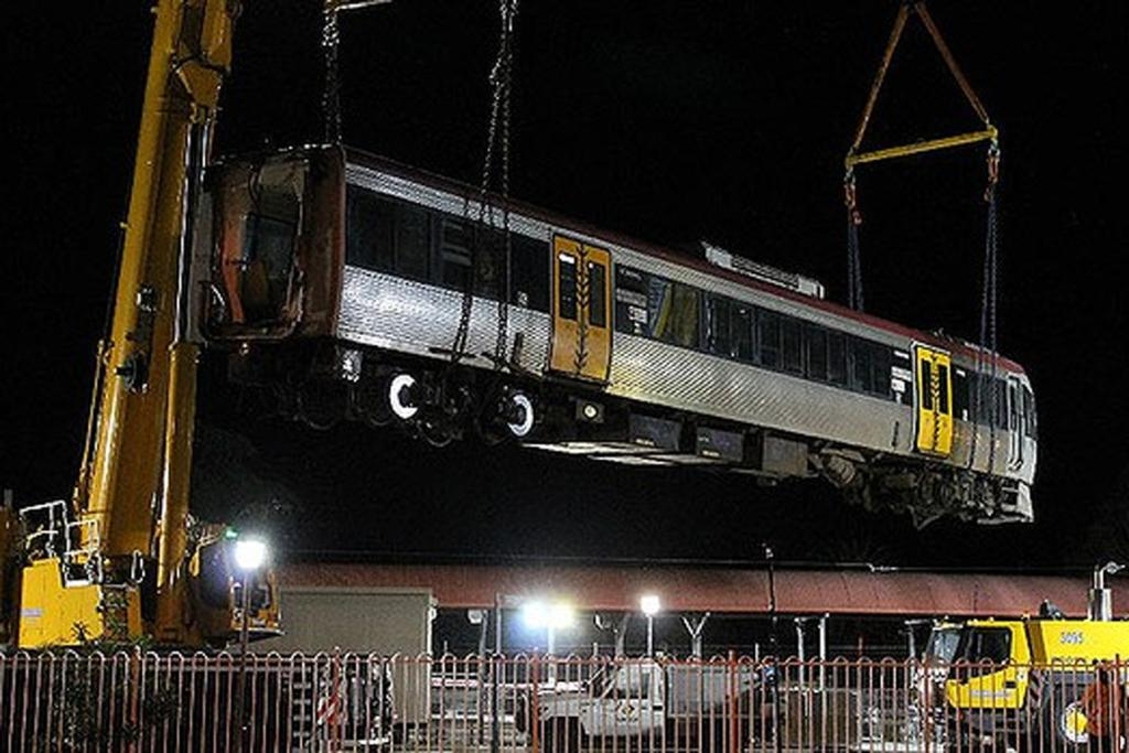 A crane was brought in to pull the train out of the station.