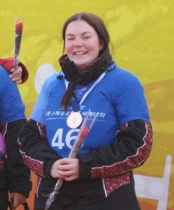 GREAT START: Brittney McKenzie on the podium at the Special Olympics World Winter Games in South Korea.