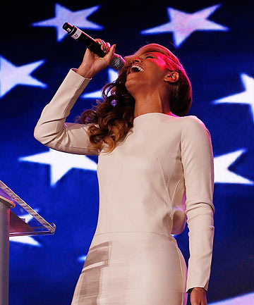 ANY QUESTIONS? Beyonce performs the national anthem during her Super Bowl press conference.