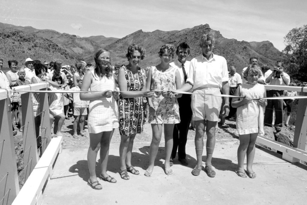 (B0066) This looks like the opening of a bridge but who are these people and where is the bridge? READER UPDATE Karen, Shirley, Shane, Ewan, Tracy and Brian Schwass (at rear). Opening of the Middlehurst Station bridge over the Awatere River. 1970.