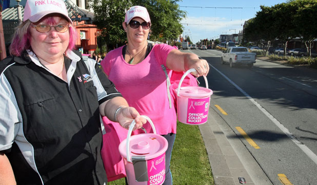 HELPING HANDS: Charity travellers Patrina Lawes and Gaeleen Scholes-Daysh collect for the Breast Cancer Foundation in Invercargill yesterday, as part of their $98.98 New Zealand tour.