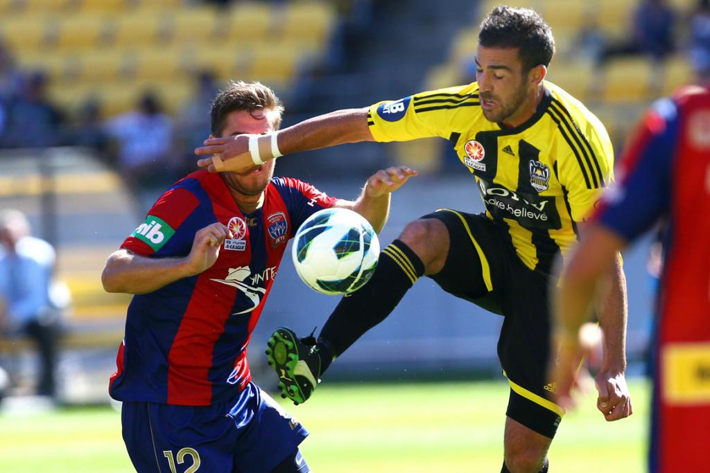 Manny Muscat and Jets' Joshua Brillante compete for the ball.