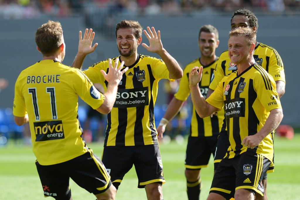 Phoenix players celebrate Jeremy Brockie's goal against the Perth Glory.