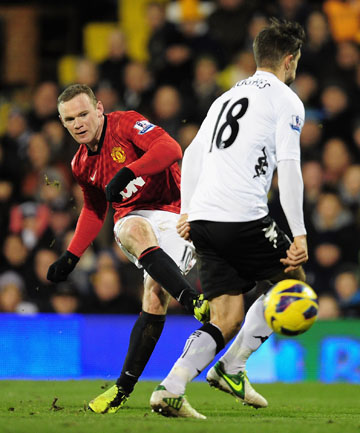 WINNER: Wayne Rooney sends the only goal of the game through to secure United's lead atop the Premier League.
