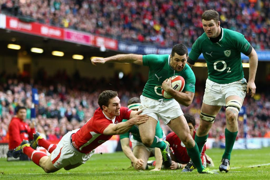 Rob Kearney of Ireland slips through the tackle of George North.