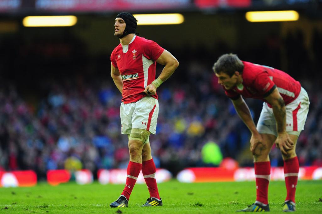 A dejected Wales side reacts after losing their opening Six Nations match to Ireland 30-22.