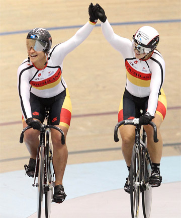 EMOTIONAL RIDE: Natasha Hansen (left) and Steph McKenzie celebrate after winning gold in the women's 500m team sprint final.
