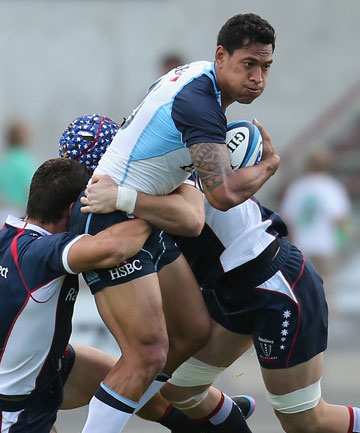 SOLID GAME: Israel Folau of the Waratahs runs with the ball during the Super Rugby trial match between the Waratahs and the Rebels.