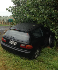 A car has skidded off the road in South Taranaki. The driver was not hurt.