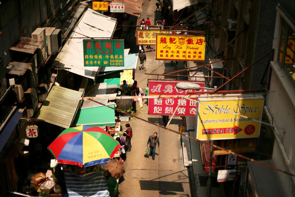 A general view of shoppers walking in the street in Hong Kong.
