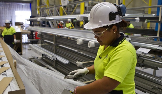 HARD AT WORK: Lesina Figota, 21,  enjoys her job at Fletchers Aluminium after three years on the unemployment benefit.