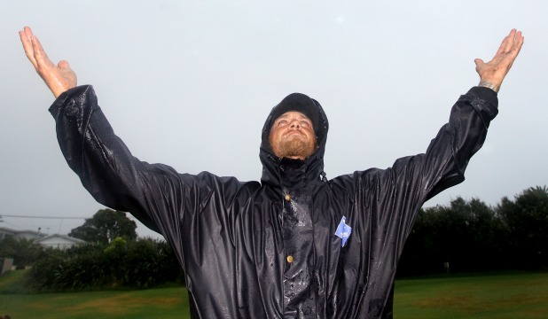 Rainy day: Fitzroy Golf Club greenkeeper Daniel Stretton found yesterday's downpours a relief after all the hot weather.